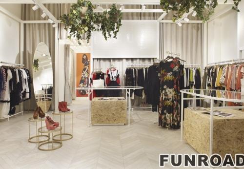 女装店木制展示柜台制作金属框架玻璃展架设计